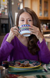 Woman eating breakfast Royalty Free Stock Photography