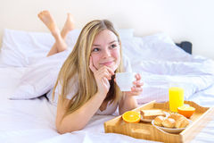 Woman eating breakfast in bed Royalty Free Stock Photo