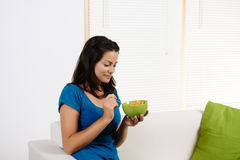 Woman  eating breakfast cereal Royalty Free Stock Image