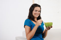 Woman  eating breakfast cereal Royalty Free Stock Photos