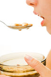 Woman eating breakfast cereal Stock Images