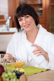 Woman eating breakfast cereal Stock Image