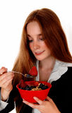 Woman eating breakfast. Royalty Free Stock Image