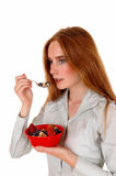 Woman eating breakfast. Stock Photo