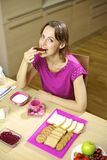 Woman eating breakfast at home in the morning Stock Photo