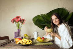 Woman Eating Breakfast - Horizontal Stock Photography