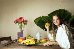 Woman Eating Breakfast - Horizontal Royalty Free Stock Photos
