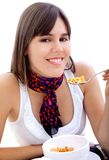 Woman eating breakfast isolated Royalty Free Stock Photography