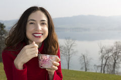 Woman eating breakfast outdoors Stock Image