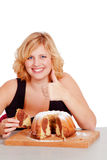 Woman eating bundt cake Royalty Free Stock Photo