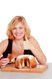 Woman eating bundt cake Royalty Free Stock Photo