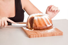 Woman eating bundt cake Stock Photos