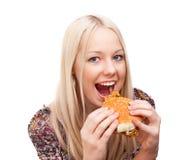 Woman eating burger Royalty Free Stock Photo