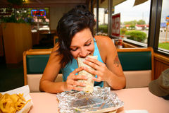 Woman eating burrito Royalty Free Stock Photography