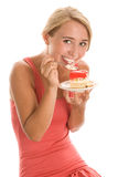Woman eating cake Stock Photos