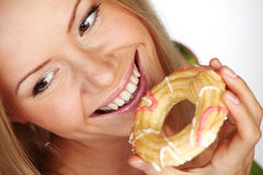 Woman eating a cake Stock Image