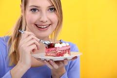 Woman eating  cake Stock Image