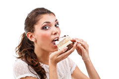 Woman eating cake Royalty Free Stock Photography
