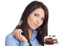 Woman eating the cake. Stock Photos