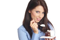 Woman eating the cake. Royalty Free Stock Photos