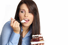 Woman eating the cake. Royalty Free Stock Photography