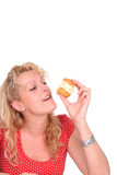 Woman eating cake Royalty Free Stock Images