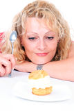 Woman eating cake Stock Images