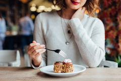 Woman eating cake in  cafe Stock Photo
