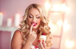 Woman eating cake closeup Royalty Free Stock Image