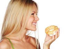 Woman eating a cake Stock Photos