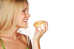 Woman eating a cake Stock Photo