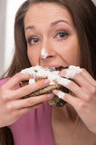 Woman eating cake. Stock Photography