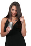 Woman eating from a can royalty free stock image