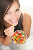 Woman eating candy Stock Images