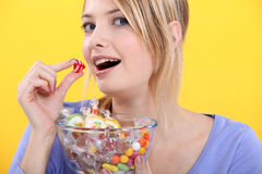 Woman eating candy Royalty Free Stock Photography