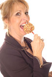 Woman eating candy apple side Royalty Free Stock Photos