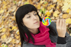 Woman eating candy lollipops Royalty Free Stock Photography