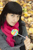 Woman eating candy lollipops Royalty Free Stock Photos