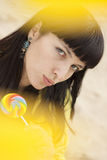 Woman eating candy lollipops Stock Photos