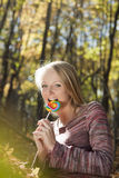 Woman eating candy lollipops Stock Photo
