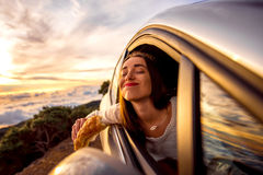 Woman eating in the car Royalty Free Stock Photography