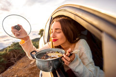 Woman eating in the car Royalty Free Stock Photo
