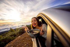 Woman eating in the car Stock Images