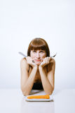 Woman eating carrot Stock Photo