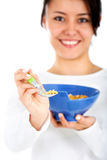 Woman eating cereal Royalty Free Stock Photography