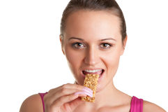 Woman Eating a Cereal Bar Stock Photos