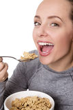Woman eating cereal Stock Photography