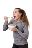 Woman eating cereal Stock Image