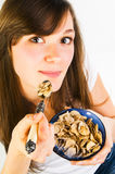 Woman eating cereal Royalty Free Stock Images