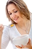 Woman eating cereals Stock Images
